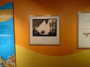 An actual original paper cut by Lotte Reiniger.  If you look at the tree in the top left hand corner you can see some damage which shows that it is paper rather than a black and white print and perhaps you can just about see a shadow too.